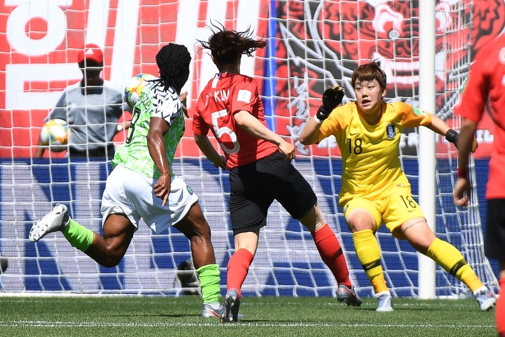 South Korea's defender Kim Do-yeon (C) scores an own goal during the France 2019 Women's World Cup Group A football match against Nigeria at the Alpes Stadium in Grenoble, central-eastern France, on Wednesday. — AFP