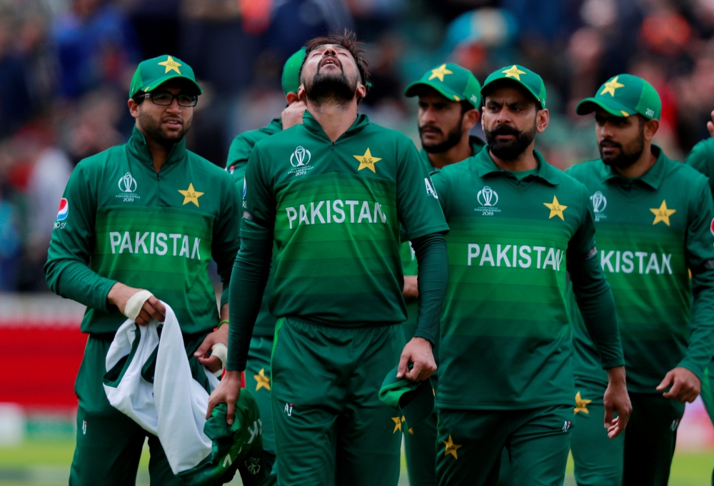 Pakistan's Mohammad Amir and teammates after Australia's innings in the ICC Cricket World Cup match at the County Ground, Taunton, Britain, on Wednesday. — Reuters