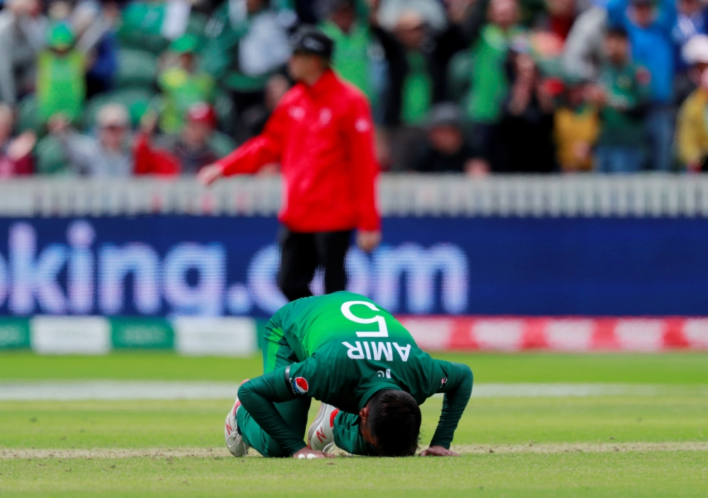 Pakistan's Mohammad Amir celebrates taking the wicket of Australia's Mitchell Starc in the ICC Cricket World Cup match at the County Ground, Taunton, Britain, on Wednesday. — Reuters