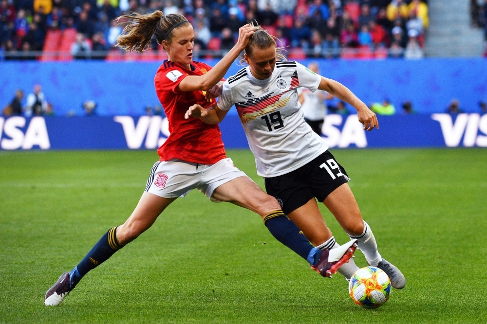 Spain's defender Irene Paredes (L) vies for the ball with Germany's forward Klara Buhl during the France 2019 Women's World Cup Group B football match on Wednesday, at the Hainaut Stadium in Valenciennes, northern France. — AFP