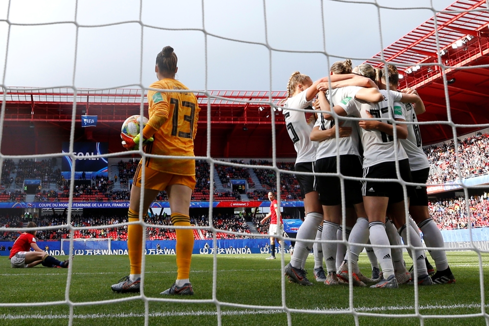 Germany's Sara Daebritz celebrates scoring their goal against Spain with teammates during the France 2019 Women's World Cup Group B football match on Wednesday, at the Hainaut Stadium in Valenciennes, northern France. — Reuters