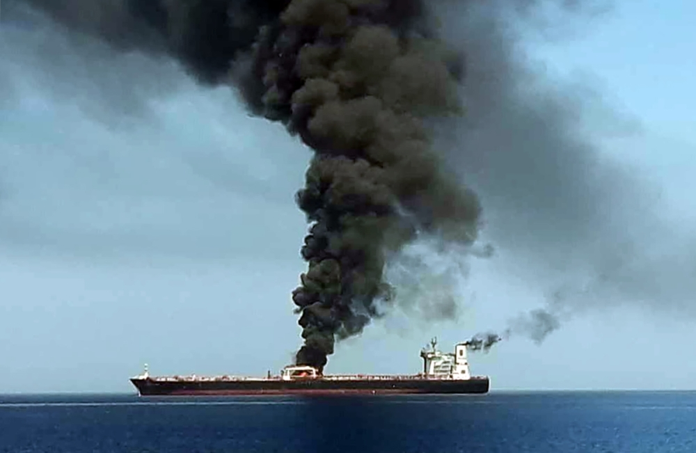 A picture obtained by AFP reportedly shows smoke billowing from a tanker said to have been attacked off the coast of Oman, at an undisclosed location. The crews of two oil tankers were evacuated off the coast of Iran today after they were reportedly attacked and caught fire in the Gulf of Oman, sending world oil prices soaring. The mystery incident, the second involving shipping in the strategic sea lane in only a few weeks, came amid spiraling tensions between Tehran and Washington, which has pointed the finger at Iran over tanker attacks in May. — AFP
