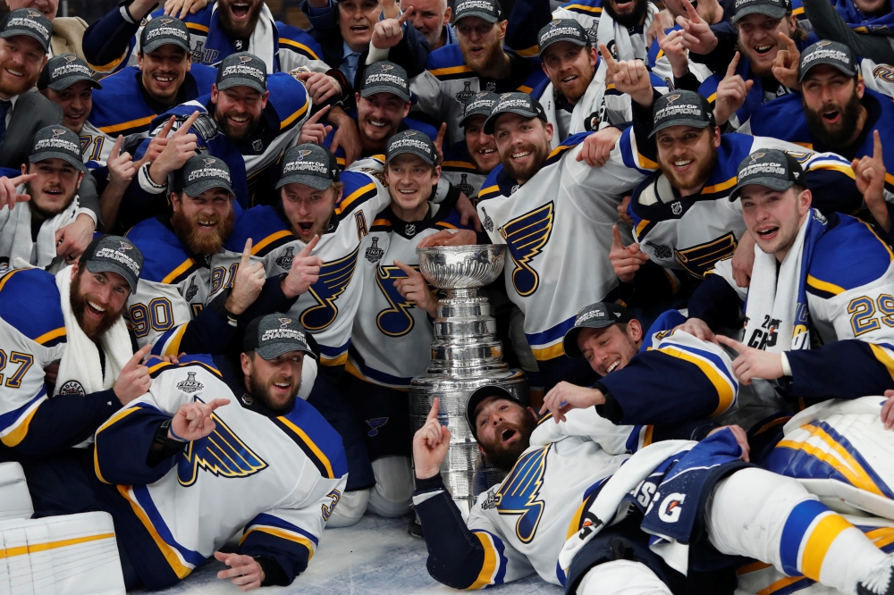 St. Louis Blues players pose for a team photo with the Stanley Cup after defeating the Boston Bruins in game seven of the 2019 Stanley Cup Final at TD Garden. — Reuters