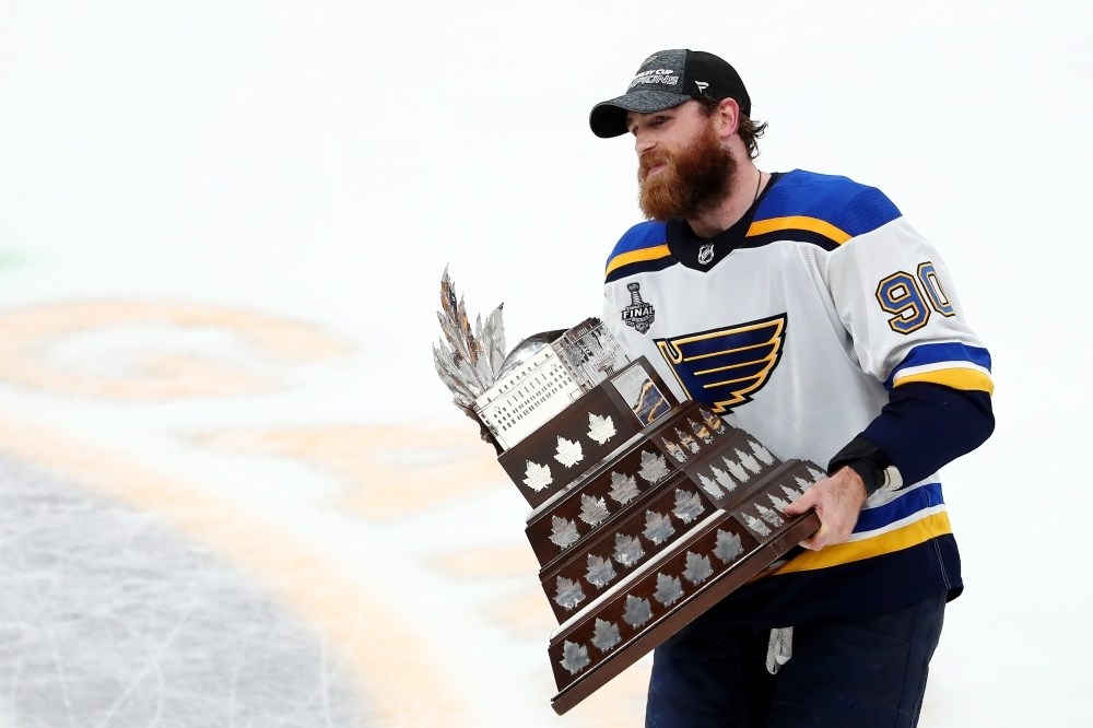 Ryan O'Reilly No. 90 of the St. Louis Blues celebrates with the Conn Smythe Trophy after defeating the Boston Bruins 4-1 to win Game Seven of the 2019 NHL Stanley Cup Final at TD Garden on Wednesday in Boston, Massachusetts. — AFP