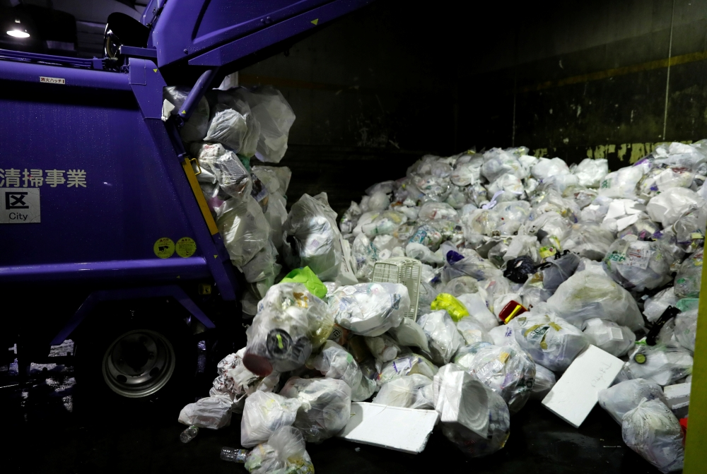 A truck unloads plastic waste for recycling at Minato Resource Recycle Center in Tokyo, Japan. — Reuters