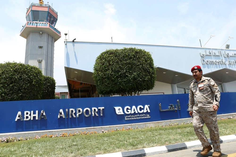 A Saudi security officer walks past the Saudi Arabia's Abha airport, after it was attacked by Yemen's Houthi group in Abha, Saudi Arabia Thursday. – Reuters