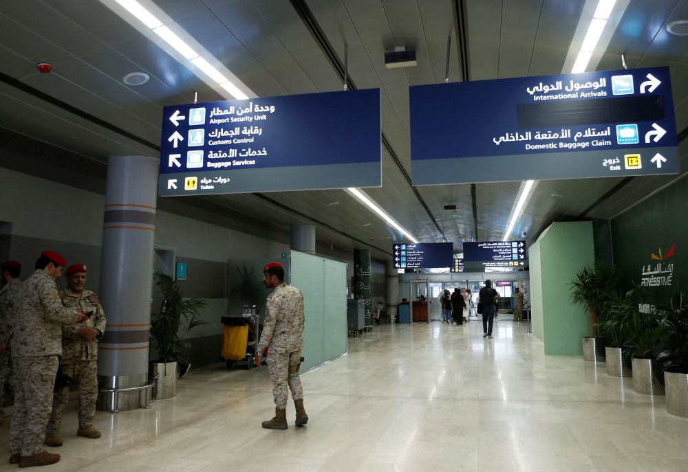 Saudi security officers are seen at Saudi Arabia's Abha airport, after it was attacked by Yemen's Houthi group in Abha, Saudi Arabia Thursday. — Reuters