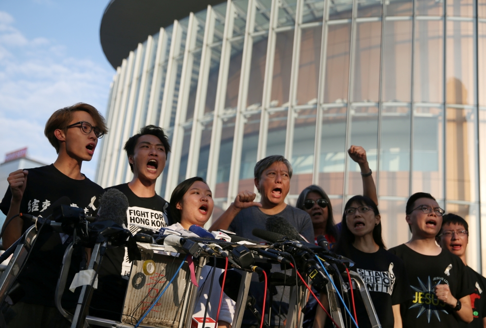Members of Civil Human Rights Front hold a news conference in response to the announcement by Hong Kong Chief Executive Carrie Lam regarding the proposed extradition bill, outside the Legislative Council building in Hong Kong, Saturday. — Reuters