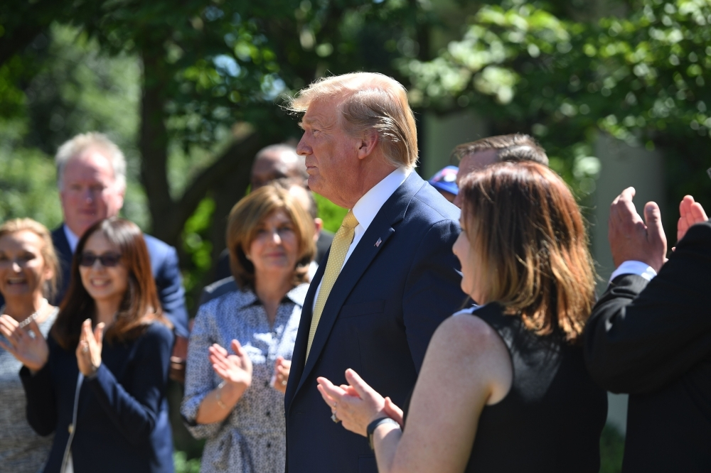 US President Donald Trump speaks during an event about expanding health coverage options for small businesses and workers in the Rose Garden of the White House in Washington, DC, Friday. — AFP