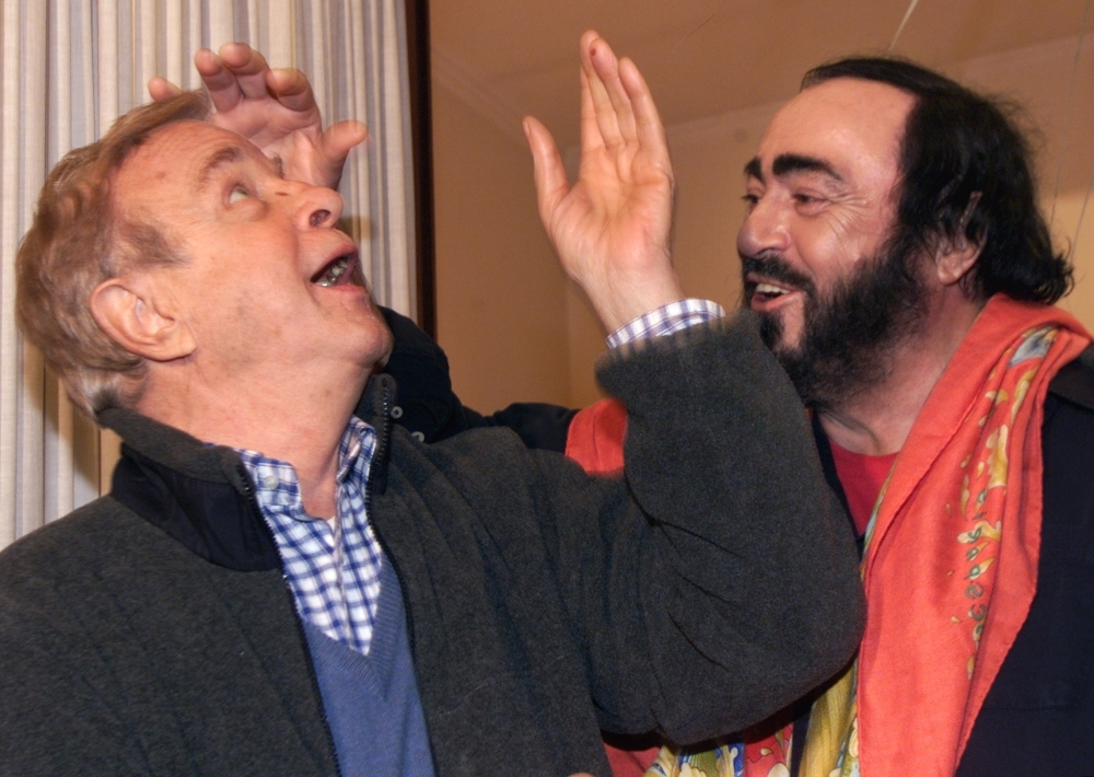 In this file photo taken on Jan. 11, 2000 Italian tenor Luciano Pavarotti (R) jokes with Italian Director Franco Zeffirelli during a press conference in Rome, three days before the first presentation of Giacomo Puccini's