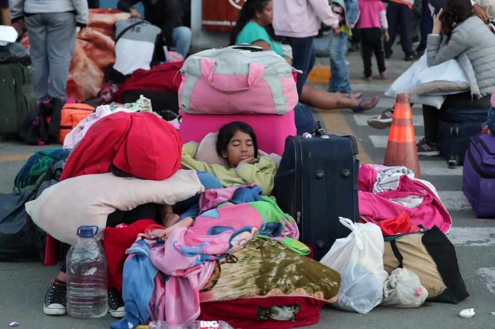 Venezuelan children sleep at the Binational Border Service Center of Peru after a new migration law was imposed for all Venezuelan migrants to have valid visas and passports, in Tumbes, Peru, Saturday. — Reuters