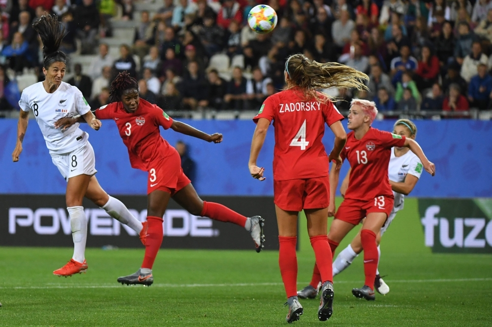 New Zealand's defender Abby Erceg (L) vies with Canada's defender Kadeisha Buchanan (2ndL) during the France 2019 Women's World Cup Group E football match on Saturday at the Alpes Stadium in Grenoble, central-eastern France. — AFP