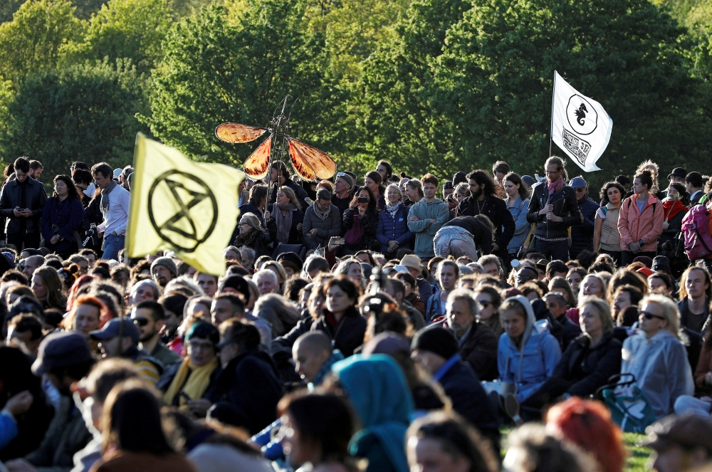 Climate change activists attend the closing ceremony of the Extinction Rebellion protests in Hyde Park, in London, Britain April 25, 2019. — Reuters file photo