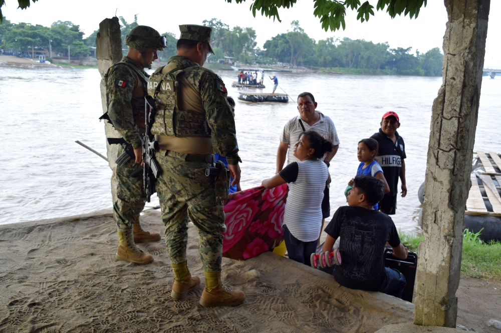 Members of naval police talk to people that crossed the Suchiate river on a raft from Tecun Uman in Guatemala to Ciudad Hidalgo, Mexico on June 16, 2019. — Reuters