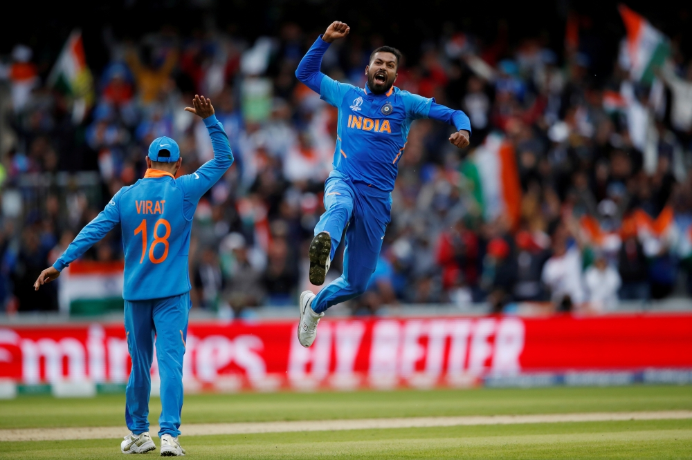 India's Hardik Pandya celebrates taking the wicket of Pakistan's Shoaib Malik during the ICC Cricket World Cup match  at the Emirates Old Trafford, Manchester, Britain on Sunday. — Reuters