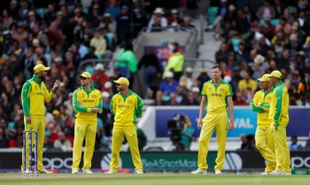 Australia's Steve Smith, David Warner and teammates look on during the ICC Cricket World Cup match against Sri Lanka at the Kia Oval, London, Britain, on Saturday. — Reuters