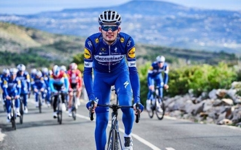 Denmark's Kasper Asgreen took the overall lead after stage two of the Tour de Suisse on Sunday.