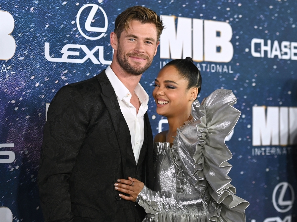 In this file photo Australian actor Chris Hemsworth and US actress Tessa Thompson attend the