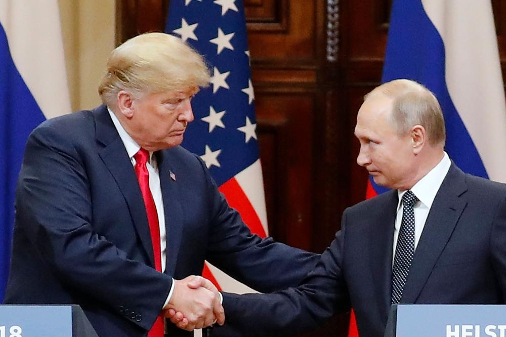 US President Donald J. Trump (L) and Russian President Vladimir Putin (R) shake hands during a joint press conference in the Hall of State at Presidential Palace following their summit talks, in Helsinki, Finland, in this 16 July 2018, file photo.