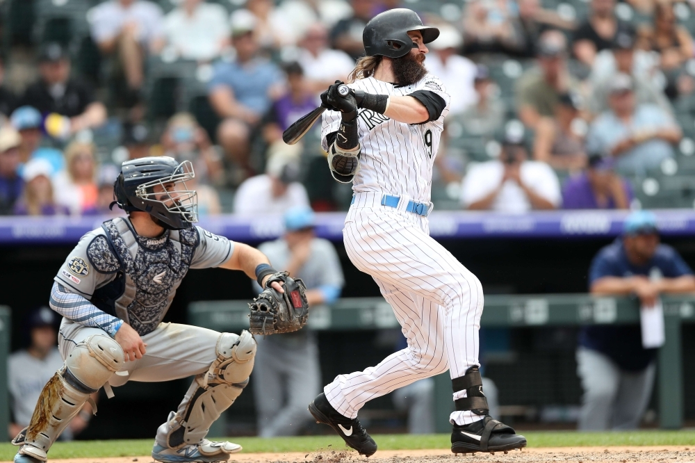Charlie Blackmon No. 19 of the Colorado Rockies hits a RBI single in the sixth inning against the San Diego Padres at Coors Field on Sunday in Denver, Colorado. — AFP