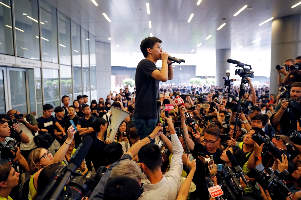 Pro-democracy activist Joshua Wong addresses the crowds outside the Legislative Council during a demonstration demanding Hong Kong's leaders to step down and withdraw the extradition bill, in Hong Kong, China, on Monday. — Reuters