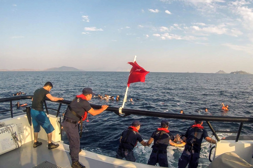 This handout picture released and taken on Monday by the Turkish coastguard shows illegal migrants being rescued after their boat sank in the Aegean sea, off the coast of southwestern Turkey. — AFP
