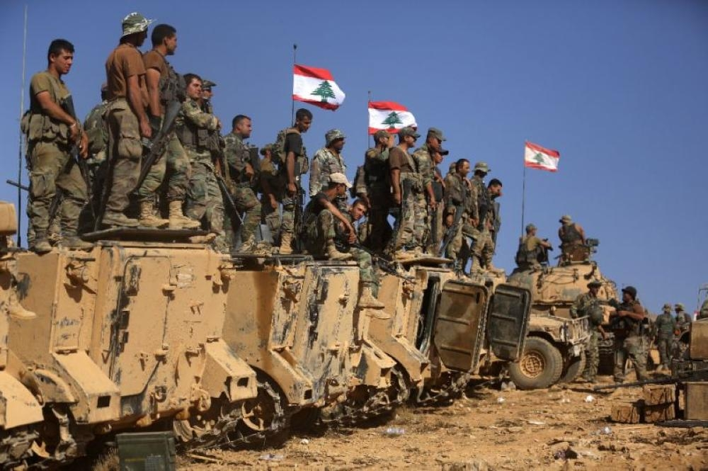 Lebanese soldiers stand on armored vehicles on a hill they took from Daesh (the so-called IS) in Jurud Ras Baalbek on the Syrian-Lebanese border, in this Aug. 28, 2017 file photo. — AFP