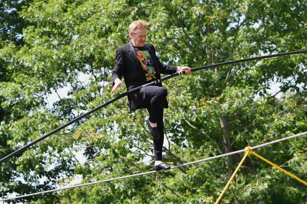 AGE NO BAR: French high wire artist Philippe Petit performs an aerial walk to launch the celebration of the 70th anniversary of Philip Johnson's Glass House at their summer party in New Canaan, Connecticut, in this June 9, 2019 file photo. — AFP