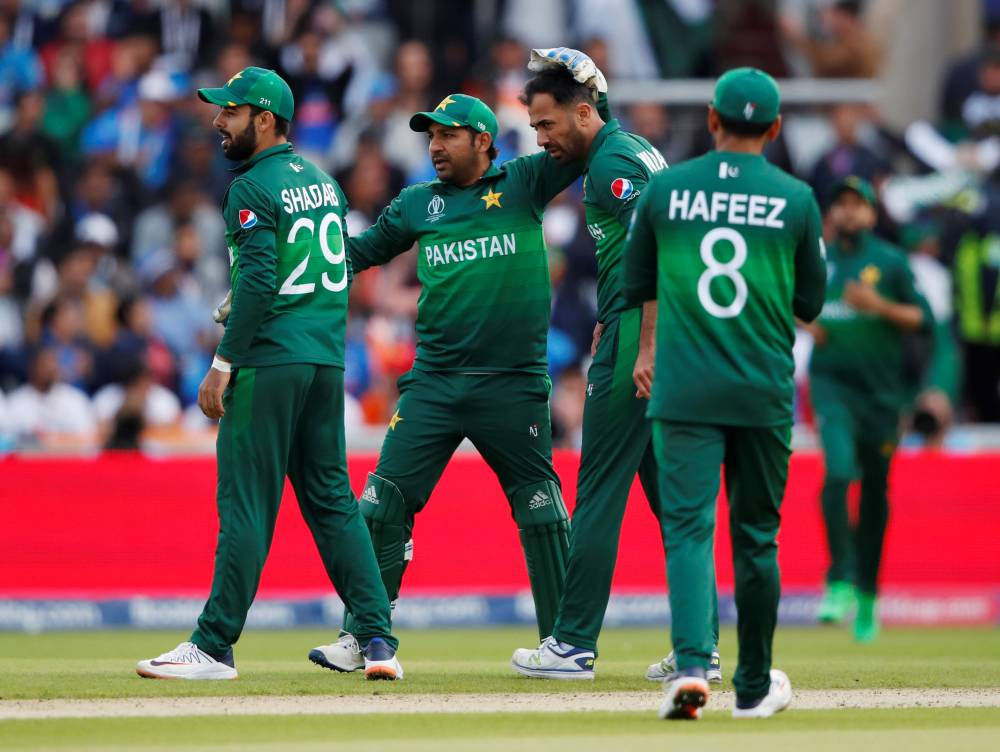 Pakistan's Sarfaraz Ahmed with teammates during the ICC Cricket World Cup match against India at the Emirates Old Trafford, Manchester, Britain, on Sunday. —  Reuters