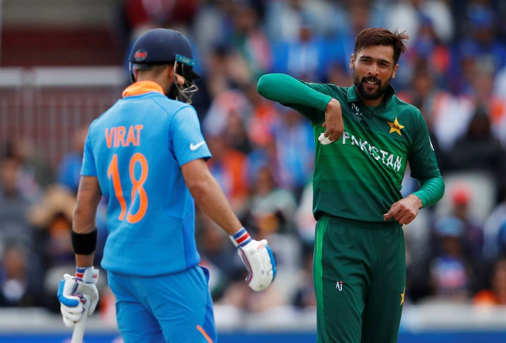 Pakistan's Mohammad Amir and India's Virat Kohli during the ICC Cricket World Cup match at Emirates Old Trafford, Manchester, Britain, on Sunday. — Reuters