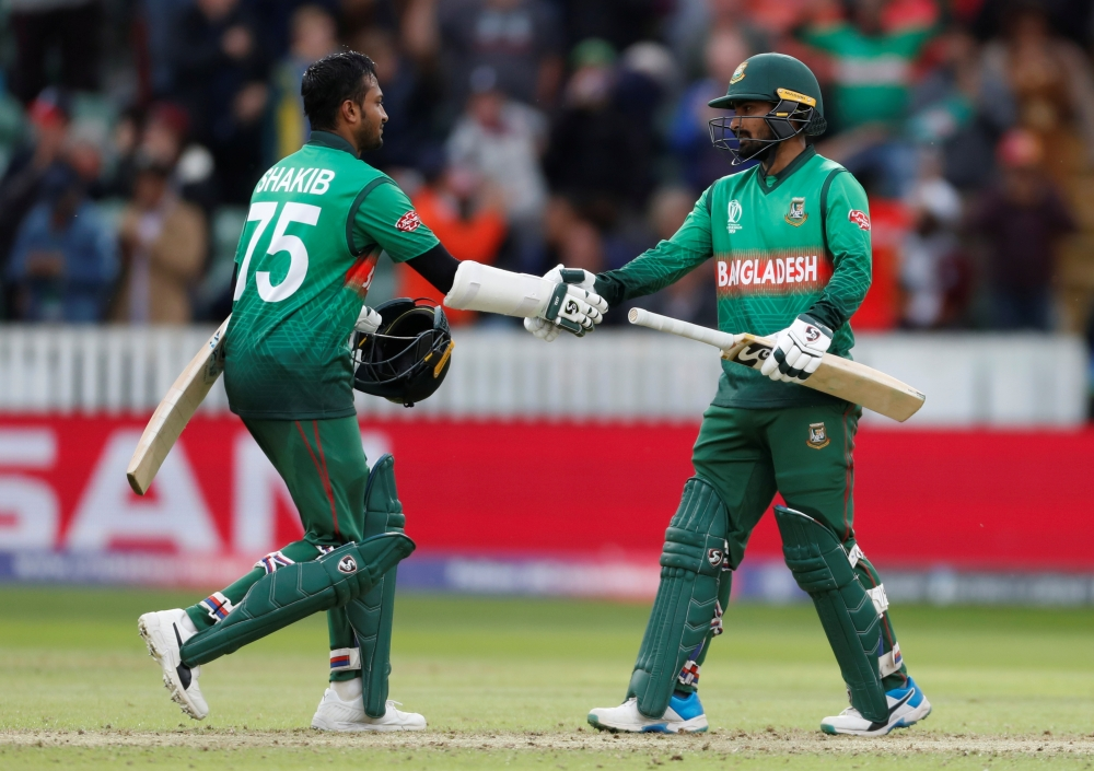 Bangladesh's Shakib Al Hasan and Liton Das celebrate winning the the ICC Cricket World Cup match against West Indies at The County Ground, Taunton, Britain, on Monday. — Reuters