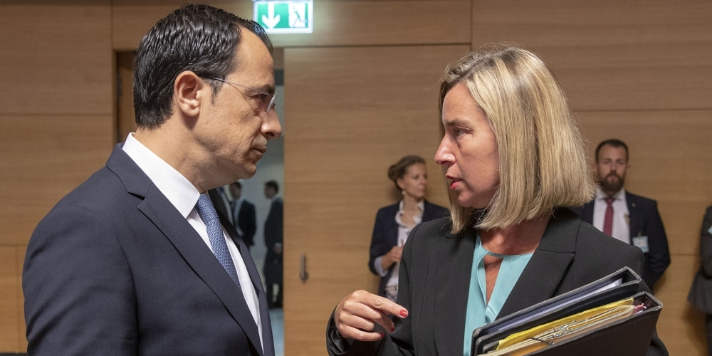 Cypriot Minister of Foreign Affairs Nikos Christodoulides (L) meets with European Union Foreign Policy Chief Federica Mogherini during the EU Foreign Affairs Council, in Luxembourg on Monday. — AFP