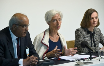 International Monetary Fund (IMF) managing Director Christine Lagarde (C) speaks during a press conference during an Eurogroup meeting at the EU headquarters in Luxembourg. — AFP