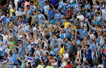 Uruguay fans on the stand during the Group C match against Ecuador at the Mineirao Stadium, Belo Horizonte, Brazil, on Sunday. — Reuters