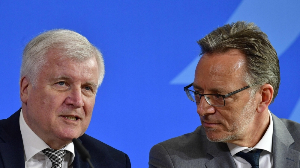 German Interior Minister Horst Seehofer, left, talks to the president of the Federal Criminal Police Office (Bundeskriminalamt) Holger Muench at the end of a press conference in Berlin on Monday. — AFP