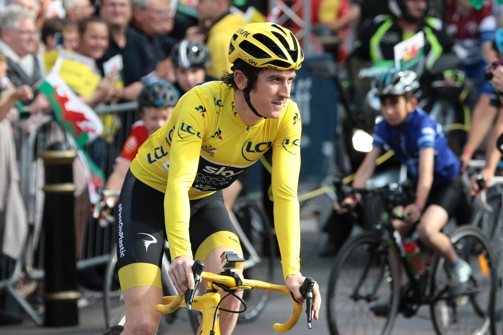 In this file photo taken on Aug. 9, 2018. Britain's Geraint Thomas rides during a celebratory homecoming event in Cardiff, south Wales following Thomas's victory in the Tour de France cycling race. Geraint Thomas of team Ineos fell heavily Tuesday during the Tour de Suisse (Tour of Switzerland) cycling race near Lausanne. Thomas came down heavily in the peloton's high-pace pursuit of an escape, and was still sitting ashen-faced on the tarmac five minutes later with doctors gingerly examining his shoulder. — AFP