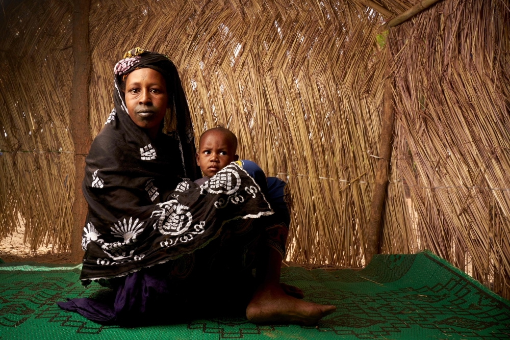 Fatouma Barry, 25, poses with her baby in a refugee camp in Bamako in this May 13, 2019 file photo. — AFP