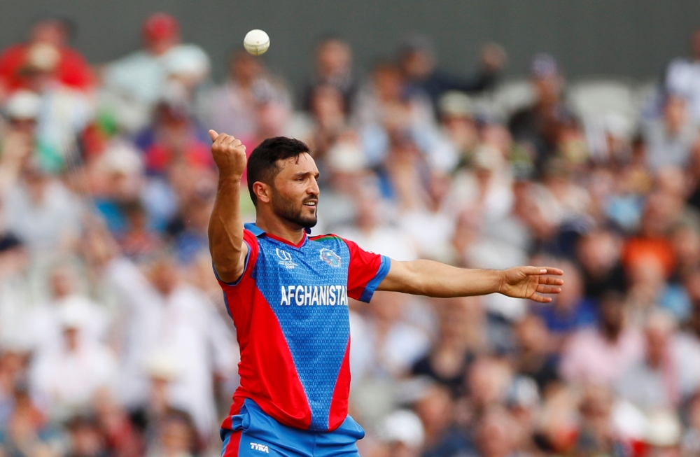 Afghanistan's Gulbadin Naib celebrates the wicket of England's Jonny Bairstow   during the ICC Cricket World Cup match at the Old Trafford, Manchester, Britain, on Tuesday. — Reuters