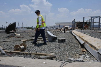A picture taken on June 13 shows a worker inspecting the damage at Abha airport, one day after a Yemeni rebel missile attack on the civil airport, wounding 26 civilians. — AFP