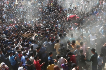 People carry the bodies of Sajjad Ahmad Bhat and Tawseef Ahmad Bhat, suspected militants, who were killed during a gun battle with Indian security forces today, according to local media, during their funeral procession in Marhama village in South Kashmir's Anantnag district on Tuesday. — Reuters