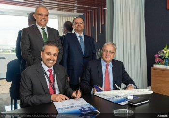 Eng. Saleh bin Nasser Al-Jasser, Director General of Saudi Arabian Airlines (left), and Christian Scherer, Airbus Chief Commercial Officer, sign the purchase agreement