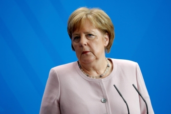 German Chancellor Angela Merkel looks on during a press conference with Ukraine's new president on his first official visit to Germany at the Chancellery in Berlin on Tuesday. — AFP
