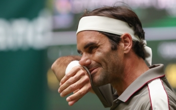 Switzerland's Roger Federer reacts during the first round tennis match against Australia's John Millman at the ATP Open tennis tournament in Halle, western Germany, on Tuesday. — AFP