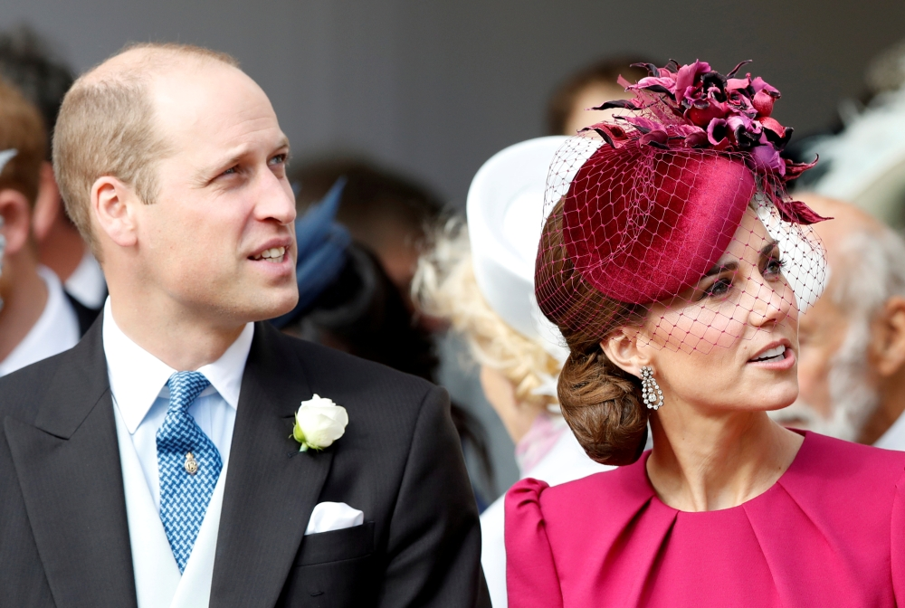 Prince William and Kate, Duchess of Cambridge, look up at the Royal Standard flying from the round tower following the wedding of Princess Eugenie of York and Jack Brooksbank in St. George's Chapel, Windsor Castle, near London, in this Oct. 12, 2018 file photo. — Reuters