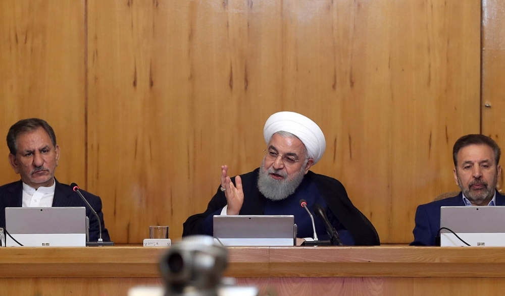 President Hassan Rohani (C) and Iran's First Vice President Eshaq Jahangiri (C) attending a cabinet meeting in Tehran. — AFP