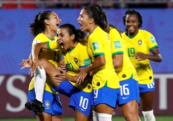 Brazil's Marta celebrates scoring their first goal with teammates during the Women's World Cup Group C match against Italy at the Stade du Hainaut, Valenciennes, France, on Tuesday. – Reuters