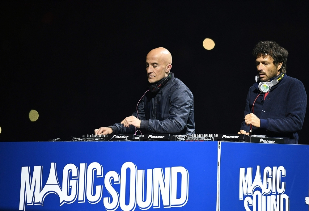 French DJ duo Cassius, Philippe Zdar, right, and Hubert Boombass, left, are pictured during the French L1 football match between Paris Saint-Germain and Nantes at the Parc des Princes stadium in Paris in this May 14, 2016 file photo. — AFP