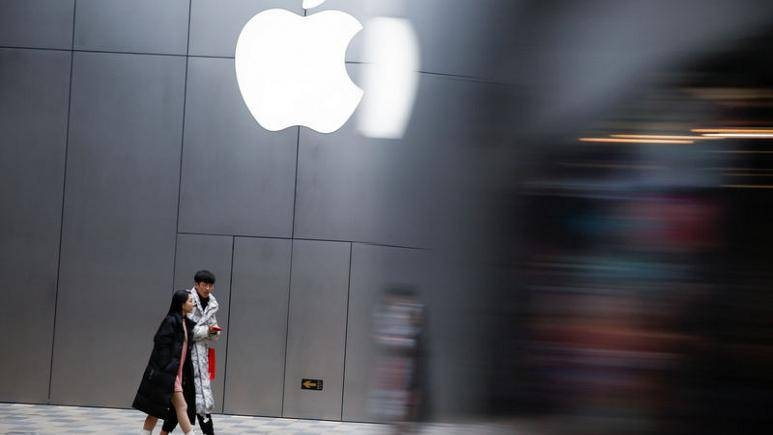 People walk past an Apple store in Beijing, China. — Reuters