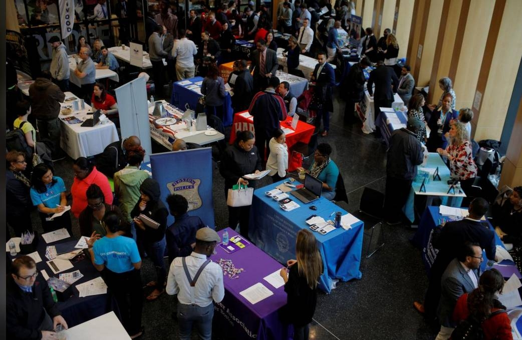 Job seekers speak with potential employers at a City of Boston Neighborhood Career Fair on May Day in Boston, Massachusetts, in 2017. — Reuters file photo