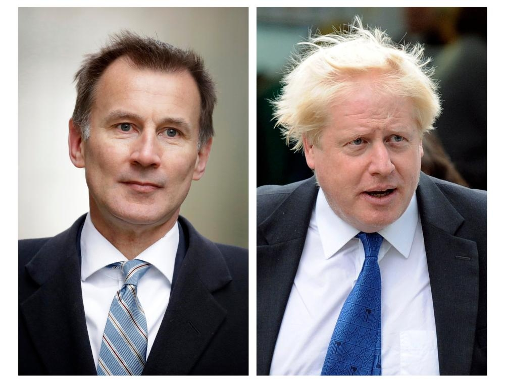 British Foreign Secretary Jeremy Hunt, left, and former British Foreign Secretary are seen in this file combo picture. — AFP